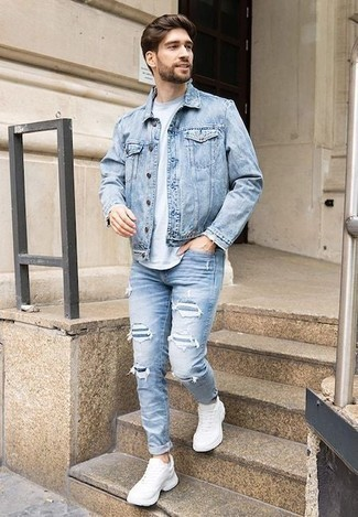 How to Wear a Light Blue Crew-neck T-shirt For Men: A light blue crew-neck t-shirt and light blue ripped jeans are both versatile menswear must-haves that will integrate nicely within your casual arsenal. For extra style points, introduce white athletic shoes to the mix.
