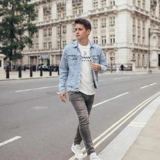 White and Black Print Crew-neck T-shirt Outfits For Men: This pairing of a white and black print crew-neck t-shirt and grey skinny jeans is on the casual side yet it's also dapper and really sharp. Shake up your look by rounding off with a pair of white canvas low top sneakers.