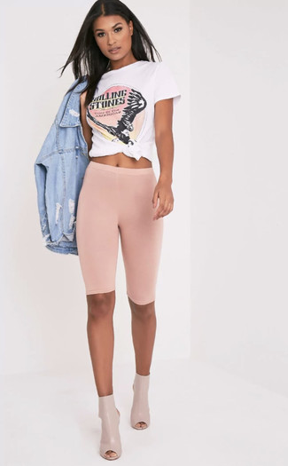 How to Wear Cutout Leather Ankle Boots: This combo of a light blue ripped denim jacket and pink bike shorts is hard proof that a pared down casual look doesn't have to be boring. If you want to easily up your ensemble with one single piece, add cutout leather ankle boots to your look.