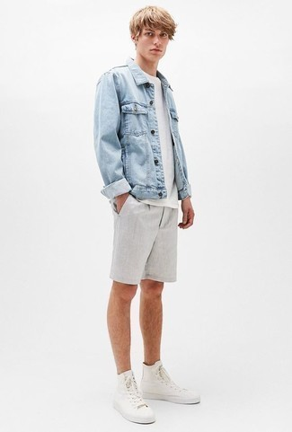 How to Wear Grey Shorts For Men: A light blue denim jacket and grey shorts are a combo that every trendsetting gentleman should have in his casual sartorial collection. Want to go easy in the footwear department? Complement this outfit with white canvas high top sneakers for the day.