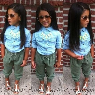 How to Wear a Light Blue Denim Long Sleeve Shirt For Girls: Suggest that your little girl dress in a light blue denim long sleeve shirt and olive trousers for a beautiful casual get-up. As far as footwear is concerned, let your little one choose a pair of white sandals.