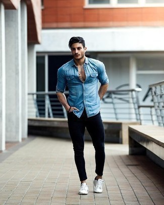 How to Wear Navy Skinny Jeans For Men: A light blue denim shirt and navy skinny jeans are among the crucial elements in any man's functional casual collection. A pair of white and black canvas low top sneakers integrates nicely within a great deal of combos.