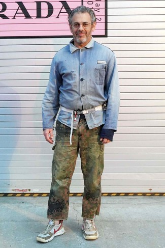 Tom Sachs wearing Light Blue Denim Shirt, Olive Camouflage Cargo Pants, Beige Athletic Shoes, White Canvas Fanny Pack