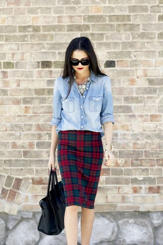 To create an outfit for lunch with friends at the weekend pair a light blue denim shirt with a red check pencil skirt.