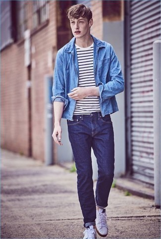 How to Wear a Light Blue Denim Shirt For Men: Pair a light blue denim shirt with navy jeans for a kick-ass ensemble. A good pair of white canvas low top sneakers pulls this look together.