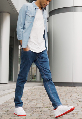 White and Red Leather Low Top Sneakers Casual Outfits For Men: Master the cool and casual ensemble by wearing a light blue denim shirt and navy jeans. Add white and red leather low top sneakers to the mix and the whole getup will come together.