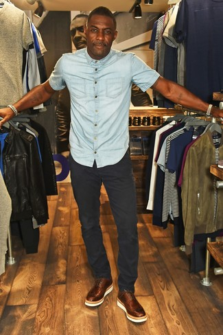 How to wear: light blue denim short sleeve shirt, black chinos, brown leather brogues