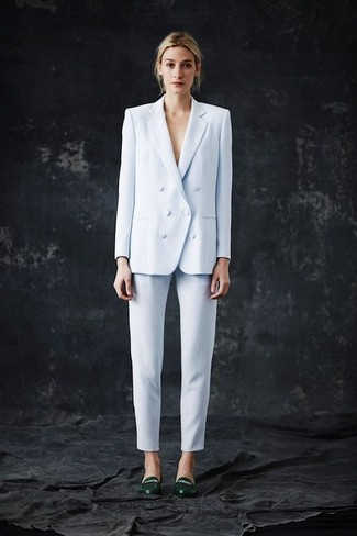 Light Blue Double Breasted Blazer Outfits For Women: Such items as a light blue double breasted blazer and light blue skinny pants are an easy way to inject effortless cool into your off-duty rotation. If not sure about what to wear when it comes to shoes, introduce a pair of dark green leather pumps to the equation.