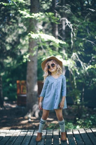 How to Wear a Beige Hat For Girls: Suggest that your girl team light blue dress with a beige hat for a fun day out at the playground. As far as footwear is concerned, suggest that your little girl go for a pair of brown boots.
