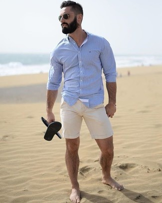 How to wear: light blue dress shirt, beige shorts, black rubber sandals, black sunglasses