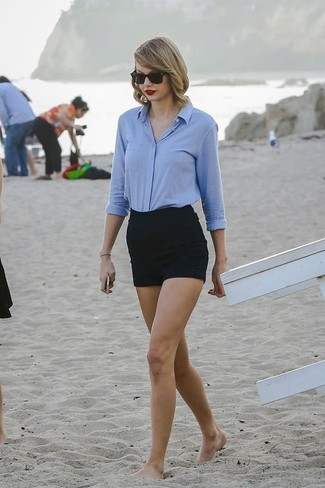 Taylor Swift wearing Light Blue Dress Shirt, Black Shorts, Black Sunglasses