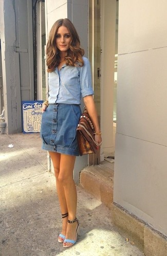 How to wear: light blue chambray dress shirt, blue denim button skirt, light blue leather heeled sandals, brown leather clutch