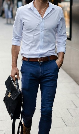 Opt for a baby blue classic shirt and navy casual trousers to achieve a dressy but not too dressy look.