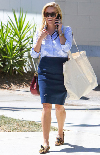 How to wear: light blue vertical striped dress shirt, navy pencil skirt, tan leopard suede tassel loafers, burgundy leather crossbody bag