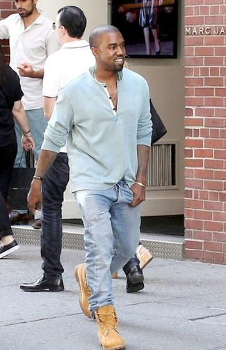 This combo of a light blue henley sweater and light blue jeans will enable you to keep your off-duty style clean and simple. Show your sartorial prowess with a pair of tan suede boots.