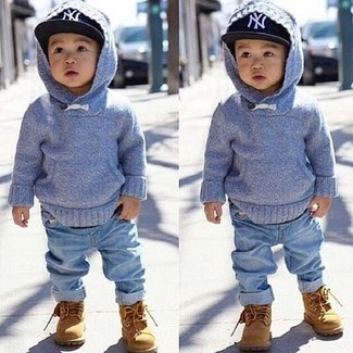 How to wear: light blue hoodie, light blue jeans, tan boots, black baseball cap