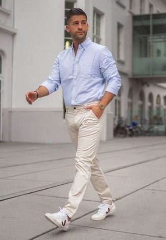 How to Wear a Long Sleeve Shirt For Men: Choose a long sleeve shirt and beige chinos to create a daily look that's full of style and personality. To infuse a dose of stylish casualness into your look, complete this getup with white and red canvas low top sneakers.