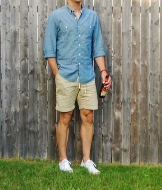 How to Wear Beige Shorts For Men: A light blue chambray long sleeve shirt and beige shorts are essential in any guy's great casual wardrobe. Rock a pair of white canvas low top sneakers for maximum effect.