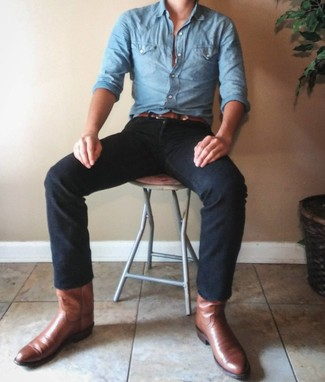 How to wear: light blue chambray long sleeve shirt, black jeans, brown leather cowboy boots, brown leather belt
