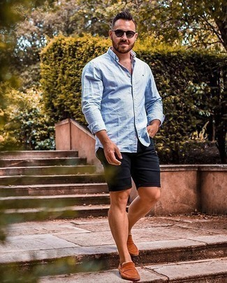 Black Shorts Outfits For Men: A light blue vertical striped long sleeve shirt and black shorts are essential in any man's well-balanced casual collection. To bring a bit of classiness to this look, choose a pair of tobacco suede loafers.