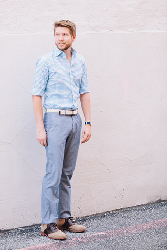 How to Wear Tan Suede Oxford Shoes: This combo of a light blue gingham long sleeve shirt and blue chambray chinos is simple, on-trend and super easy to replicate. Introduce tan suede oxford shoes to the mix to immediately rev up the style factor of any look.