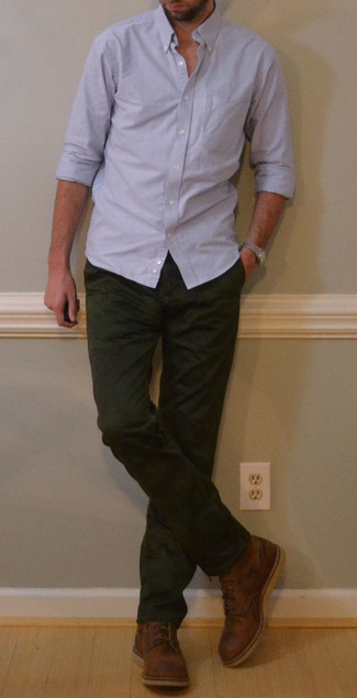 1200+ Outfits For Men In Their 30s: For something more on the casually cool side, consider pairing a light blue long sleeve shirt with dark green chinos. And if you need to easily up this ensemble with one single item, why not add brown leather casual boots to the equation? As a 30-something, you probably want to start dressing like an adult man. That's when combos like this are a surefire option.