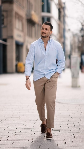 How to Wear Boat Shoes: Want to infuse your closet with some fashion-forward dapperness? Opt for a light blue long sleeve shirt and khaki chinos. As for shoes, add boat shoes to this look.