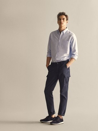 How to Wear Navy Cargo Pants: A light blue long sleeve shirt and navy cargo pants married together are a match made in heaven for gentlemen who prefer relaxed styles. Introduce a pair of navy athletic shoes to this outfit to avoid looking too polished.