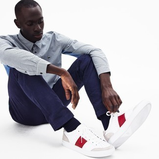 White and Red Leather Low Top Sneakers Outfits For Men In Their 20s: Display your prowess in menswear styling by combining a light blue gingham long sleeve shirt and navy chinos for a casual outfit. Add white and red leather low top sneakers to the equation and off you go looking awesome. And if we're talking casual fashion for men in their 20s, this getup is perfect.
