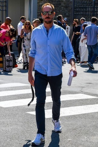 Men's Looks & Outfits: What To Wear In 2020: Fashionable and comfortable, this casual combination of a light blue long sleeve shirt and navy chinos provides with wonderful styling possibilities. To infuse a dose of stylish effortlessness into this look, complement your outfit with a pair of white athletic shoes.