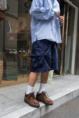 Men's Outfits 2021: This laid-back combo of a light blue vertical striped long sleeve shirt and navy shorts is super easy to pull together in next to no time, helping you look on-trend and ready for anything without spending a ton of time searching through your wardrobe. For something more on the daring side to finish this ensemble, complete your outfit with a pair of brown leather work boots.