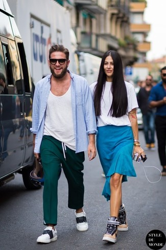How to Wear Teal Dress Pants For Men: For a look that's elegant and wow-worthy, team a light blue long sleeve shirt with teal dress pants. Feeling transgressive? Dress down your getup by finishing off with white and black low top sneakers.