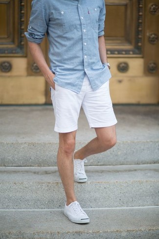 Consider wearing a baby blue chambray long sleeve shirt and shorts for a refined yet off-duty ensemble. Complement this look with white canvas low top sneakers.