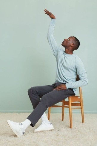 How to Wear White Leather Low Top Sneakers For Men: A light blue long sleeve t-shirt and charcoal chinos are indispensable menswear must-haves if you're crafting a casual wardrobe that holds to the highest sartorial standards. We love how a pair of white leather low top sneakers makes this look complete.