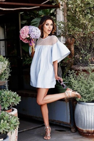 Wear a light blue sheer shift dress for a sleek elegant look. A pair of silver leather gladiator sandals will be a stylish addition to your outfit.