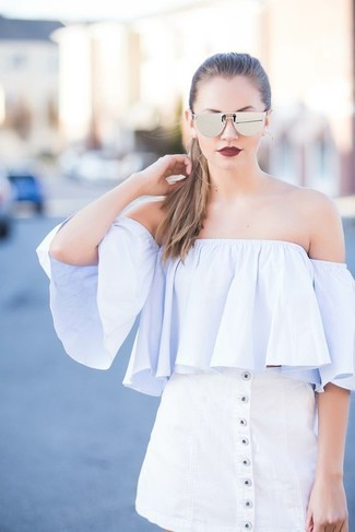 Consider teaming a light blue off shoulder top with a white button skirt for a trendy and easy going look.