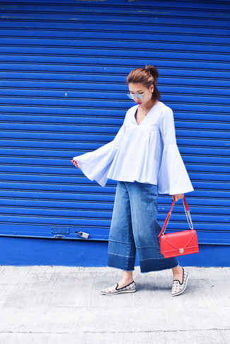 A peasant blouse and blue denim culottes are great essentials to incorporate into your current wardrobe. This outfit is complemented perfectly with white houndstooth slip-on sneakers.