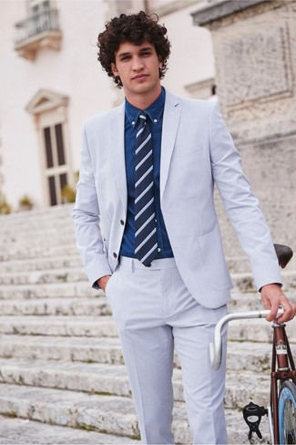 How to wear: light blue seersucker suit, navy denim shirt, navy horizontal striped tie