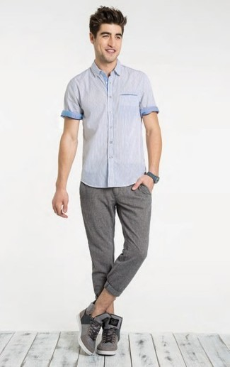 A Brooks Brothers Non Iron Traditional Fit Short Sleeve Dress Shirt and grey chinos is a nice pairing to add to your casual repertoire. If you don't want to go all out formal, rock a pair of grey high top sneakers. This outfit is also perfect if you're on a mission for warm weather wear to make a boring day in the office more bearable.