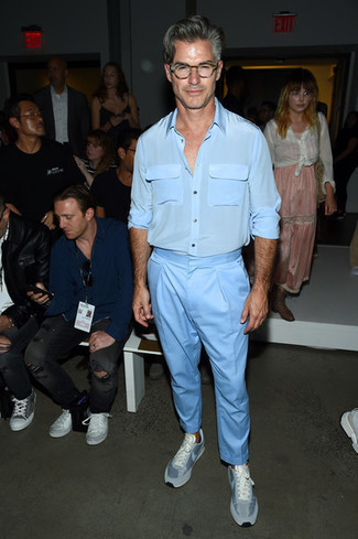 Men's Looks & Outfits: What To Wear In 2020: The pairing of a light blue silk long sleeve shirt and light blue chinos makes for a kick-ass casual ensemble. To give this outfit a more casual twist, complete this outfit with a pair of light blue low top sneakers.