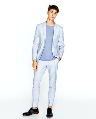 How to Wear a Light Blue Suit: We love the way this smart casual combo of a light blue suit and a light blue crew-neck t-shirt immediately makes any man look sharp. Channel your inner David Beckham and add a pair of black leather derby shoes to the equation.