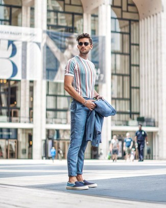 How to wear: light blue suit, multi colored vertical striped crew-neck t-shirt, navy canvas slip-on sneakers, black sunglasses