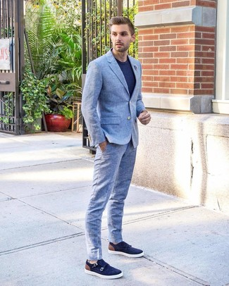 How to Wear a Light Blue Suit: For an effortlessly classic look, marry a light blue suit with a navy crew-neck t-shirt — these pieces work nicely together. A pair of navy suede double monks instantly bumps up the classy factor of any ensemble.