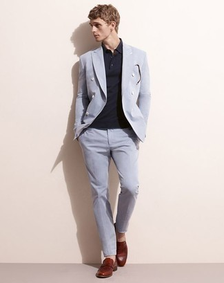 How to Wear a Light Blue Suit: For an effortlessly neat outfit, team a light blue suit with a navy polo — these items fit really well together. Introduce a pair of burgundy leather loafers to the equation for a major style boost.