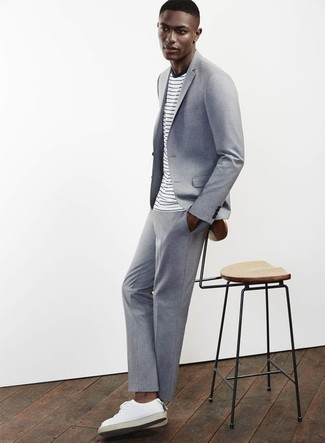How to Wear a Light Blue Suit: A light blue suit and a white and navy horizontal striped crew-neck t-shirt combined together are a perfect match. Introduce white leather low top sneakers to this outfit to make a mostly classic outfit feel suddenly fun and fresh.