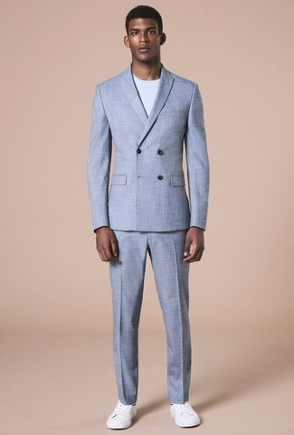 How to Wear a Light Blue Suit: A light blue suit and a white crew-neck t-shirt teamed together are a sartorial dream for those dressers who appreciate smart getups. Inject some stylish effortlessness into this look via white leather low top sneakers.