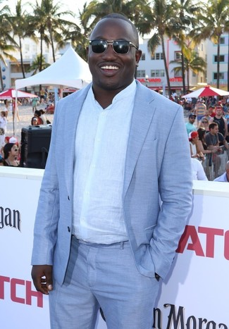 How to wear: light blue suit, white linen long sleeve shirt, black sunglasses