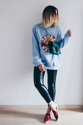 How to wear: light blue print sweatshirt, black leather leggings, red print leather espadrilles, teal leather crossbody bag