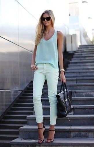 How to wear: light blue silk tank, mint skinny jeans, black leather heeled sandals, black leather tote bag