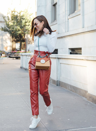 How to wear: light blue turtleneck, red leather tapered pants, white leather low top sneakers, tobacco leather crossbody bag